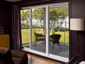 Patio doors joyce mfg co the 7500 series direct glaze fully welded sliding patio doors is available in all pvc or with a vinyl clad wood frame featuring high dp rating and planetlyrics Images